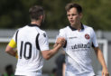 Nicky Clark and Lawrence Shankland celebrate a goal at Dumbarton.