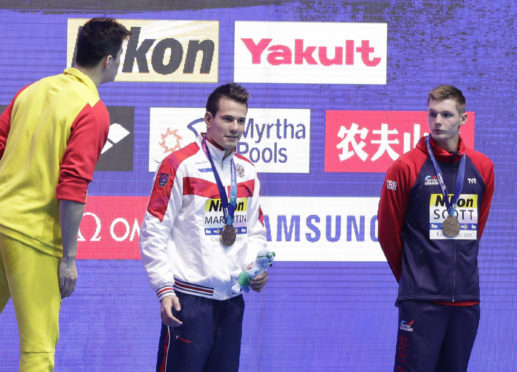 Duncan Scott keeps his distance from China's Sun Yang.