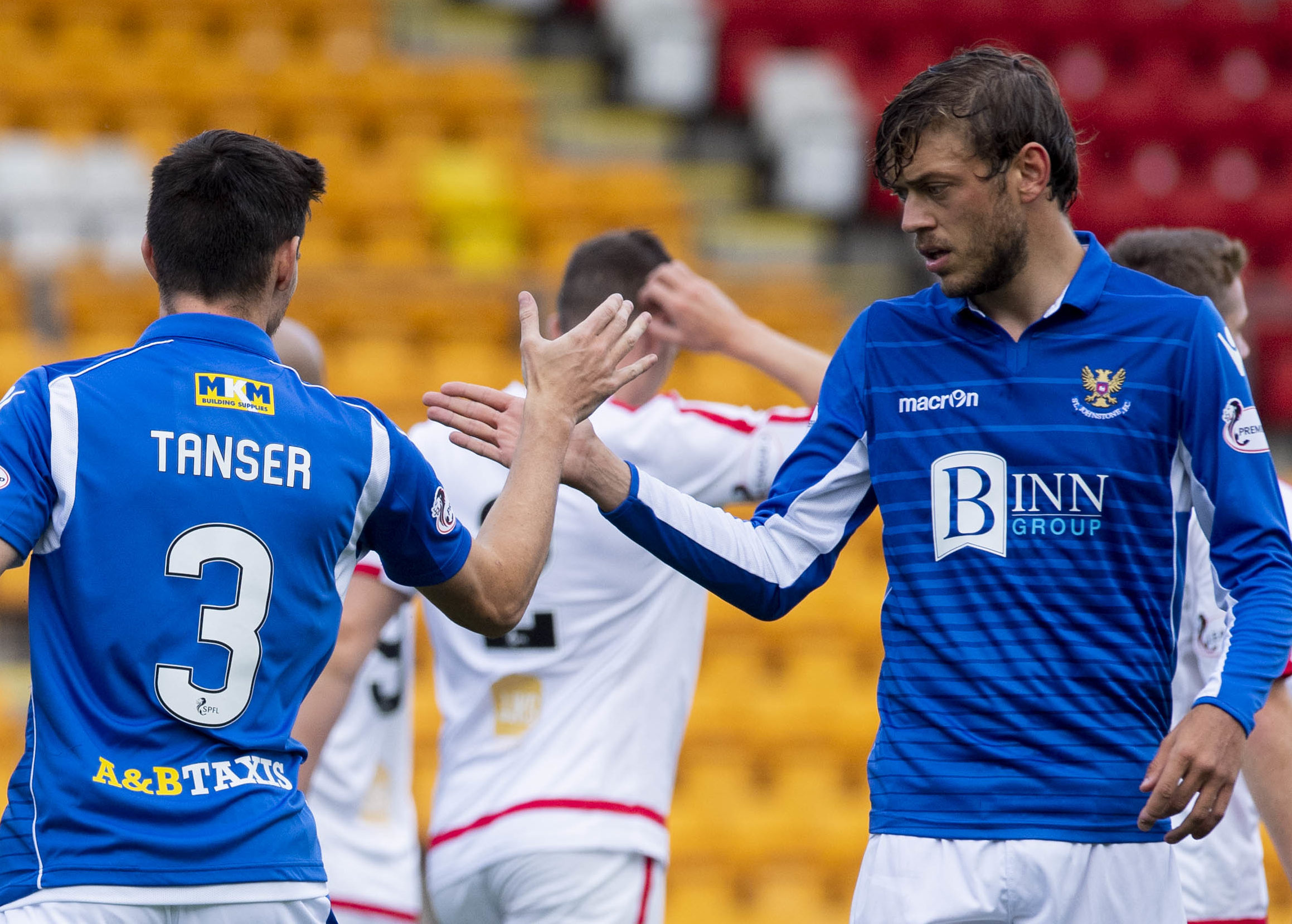 Scott Tanser celebrates his opening goal with Murray Davidson.