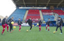 Development officer Adam McWilliam coaching  children at Links Park.