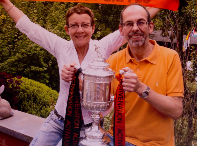 Alastair and Stella Brodie's pose with the trophy following Dundee United's cup victory.