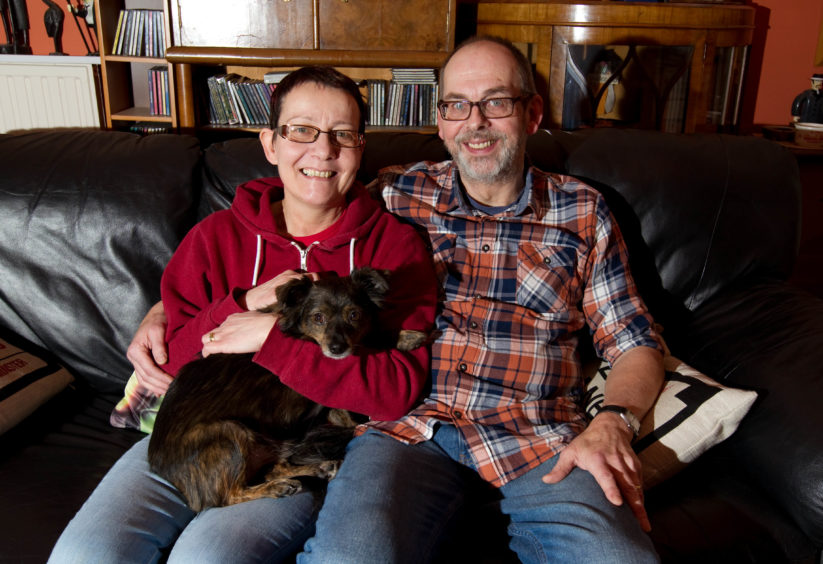 Alastair and Stella Brodie at home with their dog Pepe.
