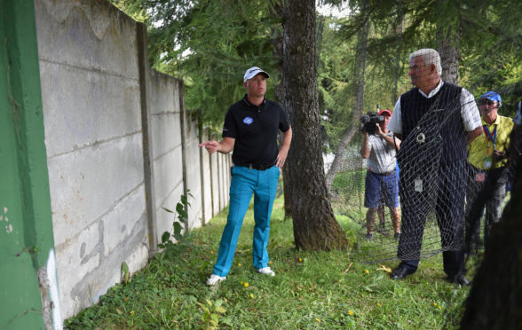 John Paramor (r), head referee of the European Tour, has been given stringent penalties to police slow play.