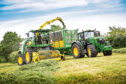 Scottish farmers are still thinking big with tractors like the John Deere 9700i SPFH .