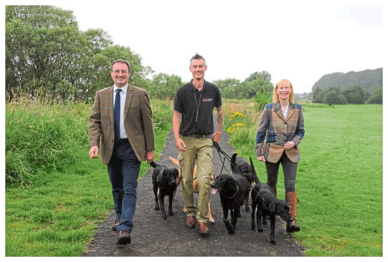 Gordon Douglas, of Second to None Dog Walking, with show president Andrew Turnbull and secretary Jane Drysdale.