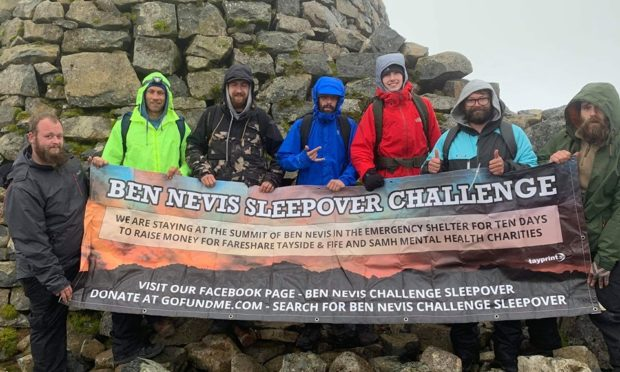 Ross, left, and Steven, right, with their support crew on top of Ben Nevis