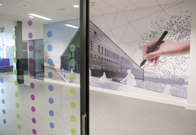 Modern wall art at the new school at Berth Park.