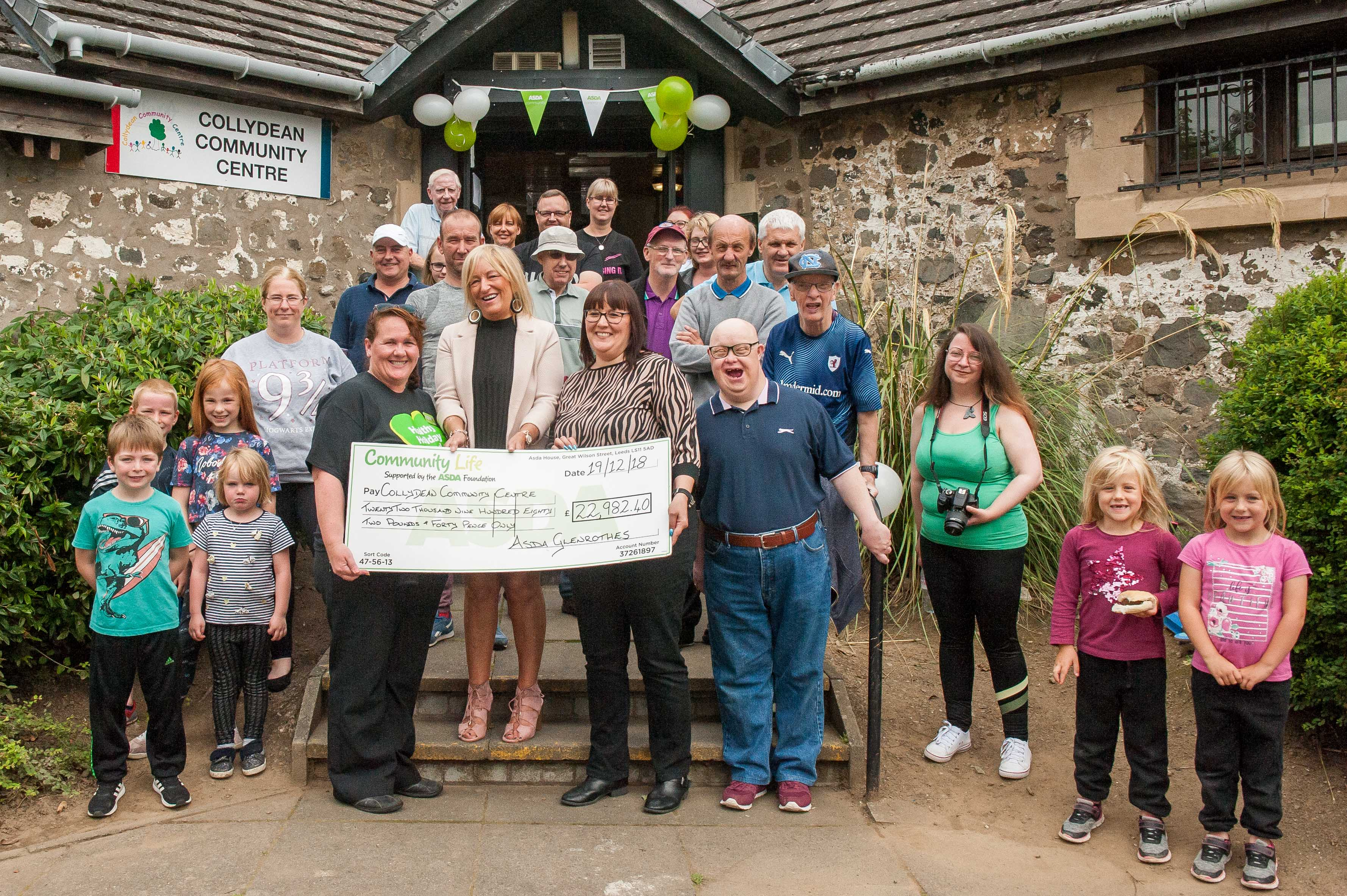 The team at the Collydean Community Cafe celebrate their windfall.