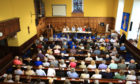 Hundreds crammed into Dunbarney Parish Church to quiz health bosses.