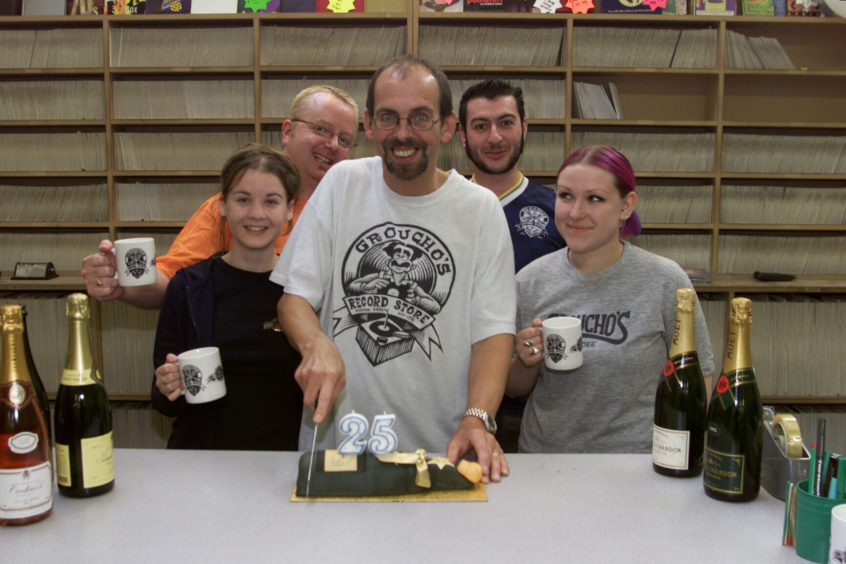 Groucho's staff celebrating the shop's 25th anniversary.