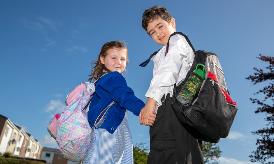 Michael and Charlotte are ready to start school.
