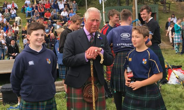 The Duke of Rothesay with High School of Dundee pupils Rowan Hart (left) and Julis Ramsay.
