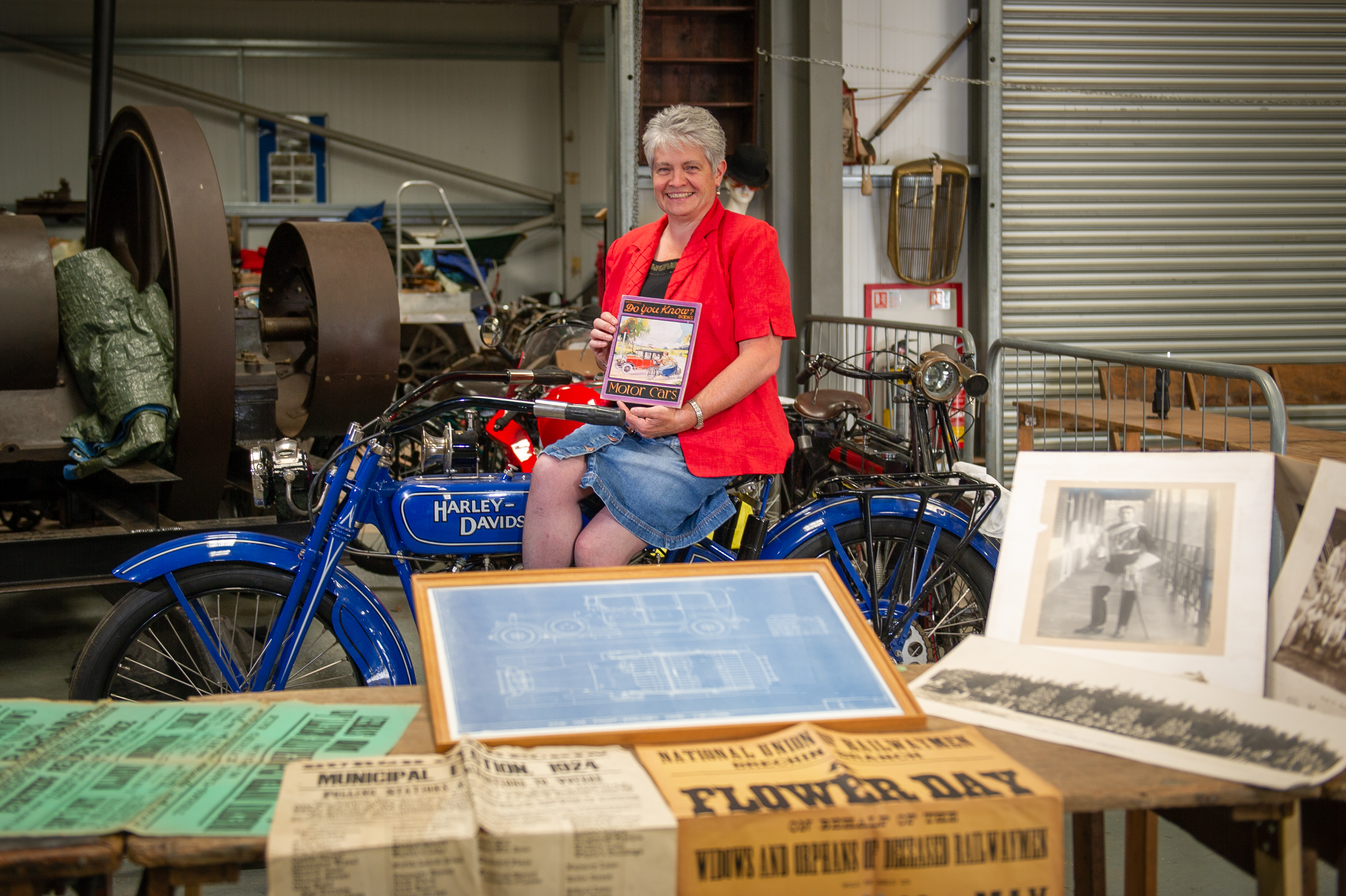 Hilary Farquharson with some of the vintage posters, photographs and books that will be on offer at the sale.