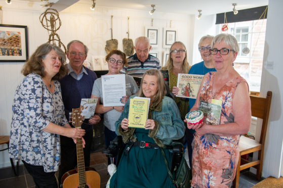 Some of the participants in the Orlang Project with the leaders (from left) musician Christine Kydd, Evan Duncan, Gail Robertson, Ian Ross, Pat McCafferty (seated front), artist Maureen Crosbie, Ginny Graham and Evelyn Bennett at Bank Street Gallery.