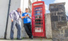 Courier News - Perth - Stefan Morkis story; CR0012898 Ross Gardiner. Picture Shows; l to r - Eddie Jackson and Steve Duffield who are in Dunkeld with the Cleveland ACF and the phone box at The Cross, Dunkeld, 13th August 2019. Pic by Kim Cessford / DCT Media