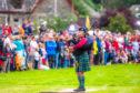 A bagpiper at Killin Highland Games