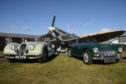 Richard Burton's Jaguar XK120 and an Austin Healey 3000 alongside the Red Lichtie replica Spitfire at Montrose in 2019
