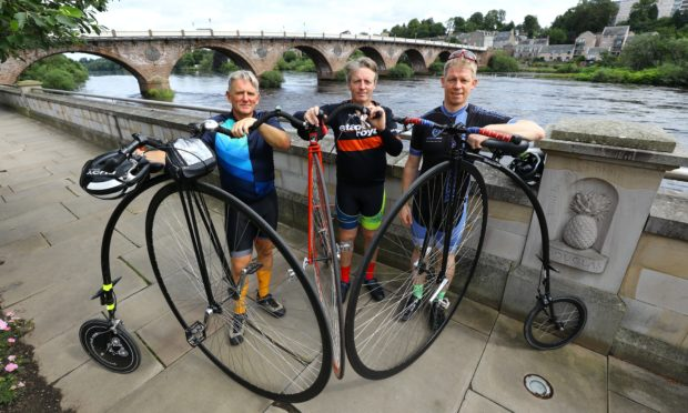 David Fox-Pitt, centre with Neil Laughton, left, and Guy Banham, right with their penny farthings in Perth today, during their charity cycle from Land's End to John O' Groats.