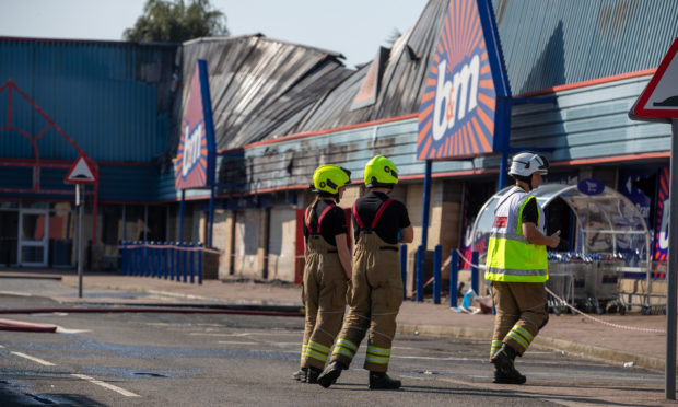 Firefighters at the scene following the fire at B&;M in Perth's St Catherine's Retail Park.