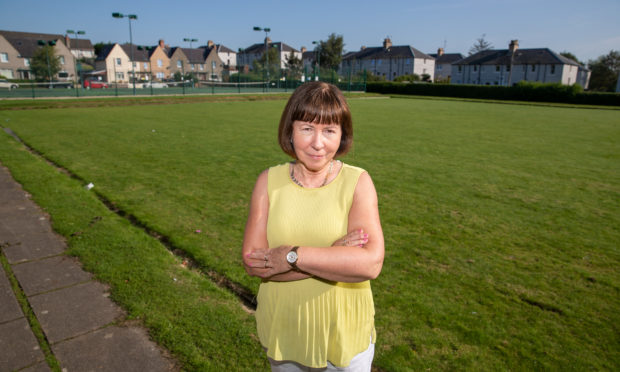 Local resident Tricia Duncan at the green where the sand is to be dumped.