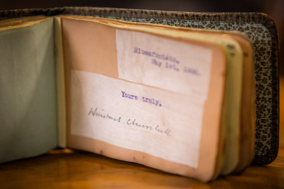 The autograph book featuring famous signatures, including Winston Churchill (pictured).  Picture Credit - Steve MacDougall.