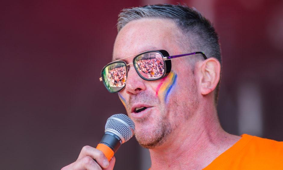 Radio Tay DJ Stuart Webster on stage.
