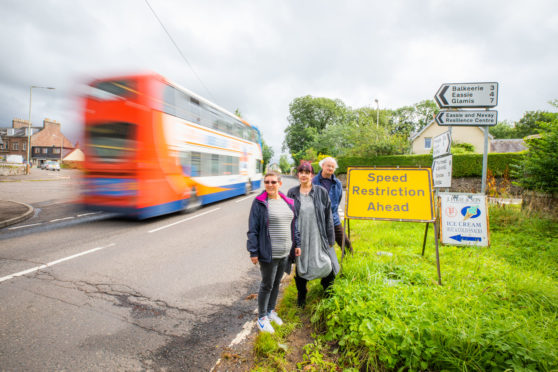 New 40mph buffer zones have been agreed for Angus communities. Pic shows Pat Small and Dudley Trefry of Newtyle and Eassie Community Council with Angus Cllr Julie Bell (centre).