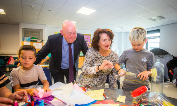 Headteacher of St John's RC Academy Seán Hagney and Perth and Kinross Council's Executive Director for Education and Children's Services Sheena Devlin meet youngsters taking part in the Taste of St John's programme.