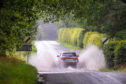 Cars drive through surface water on Castleton Road, Tullibardine, by Auchterarder, earlier in August.