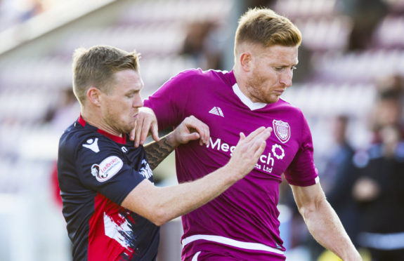 Jason Thomson, right, in action for Arbroath.