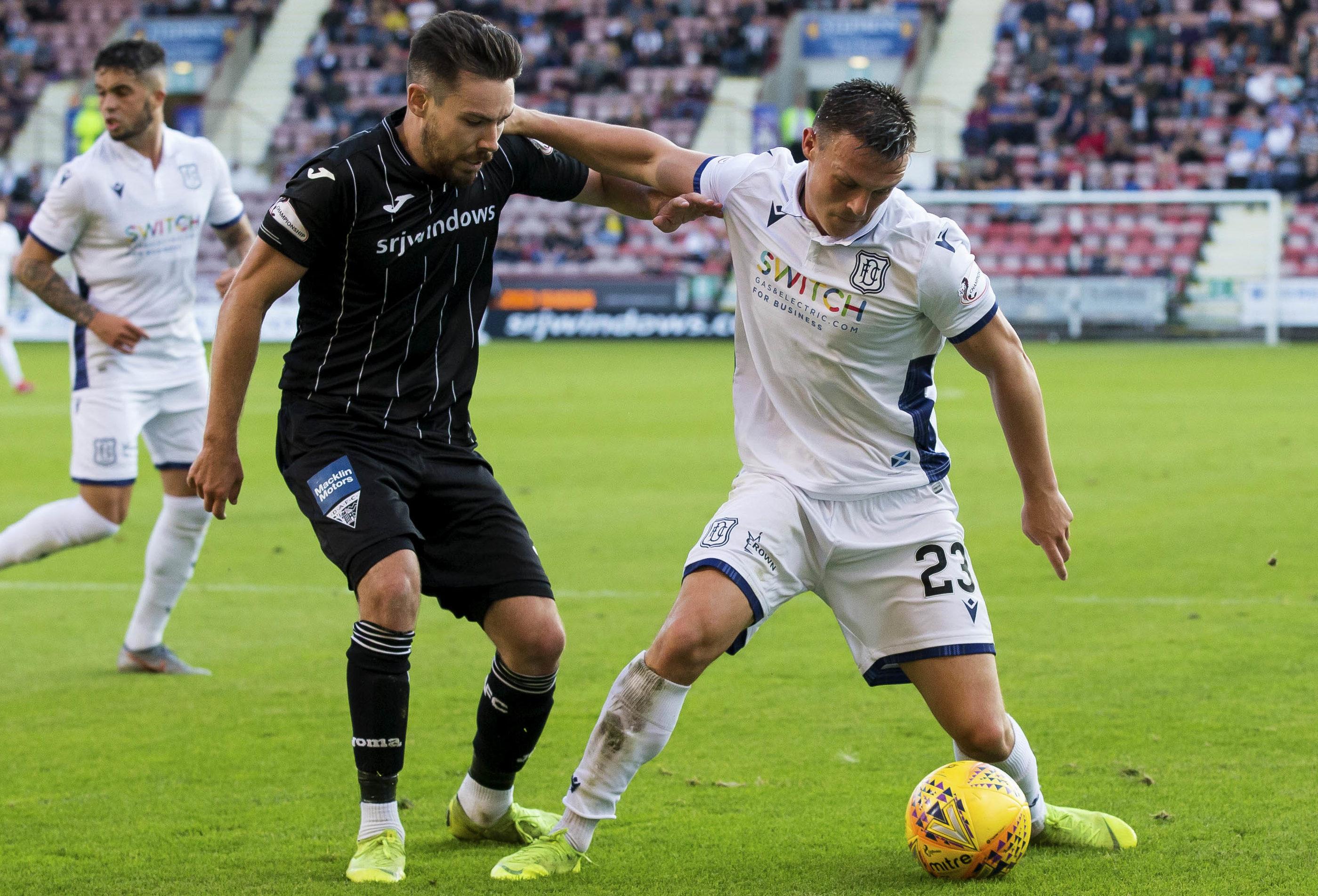 Jordan Marshall, right, holds off Dunfermline player Ryan Dow.