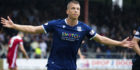 Andrew Nelson celebrates a goal for Dundee last season.