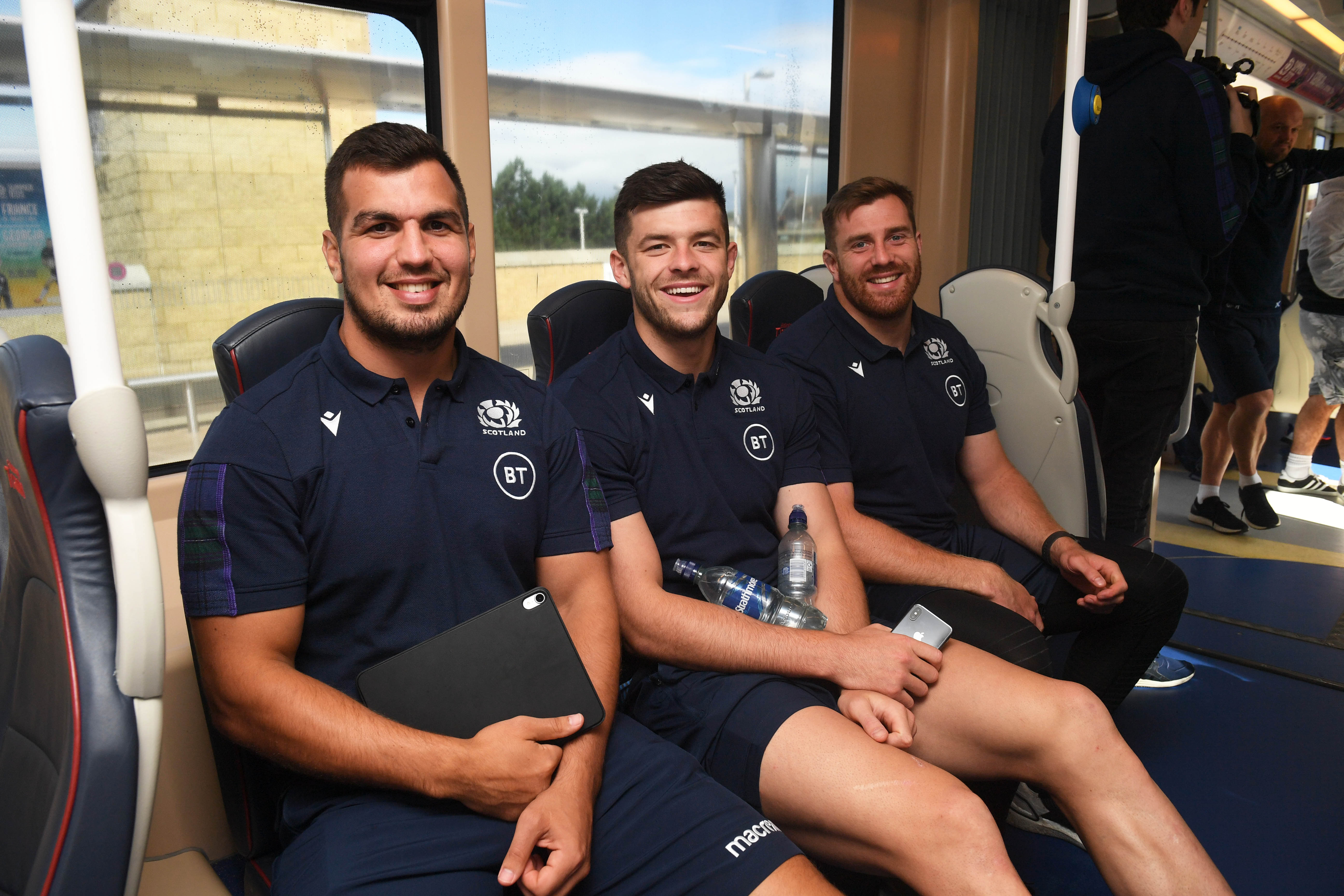 The Scotland team took the tram from Murrayfield to Edinigrh Airport on their way to Nice. (L to r) Skipper Stuart McInally, Blair Kinghorn and Simon Berghan take their seats.
