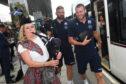 Scotland's John Barclay and Finn Russell arrive via tram at Edinburgh Airport on their way to Nice.