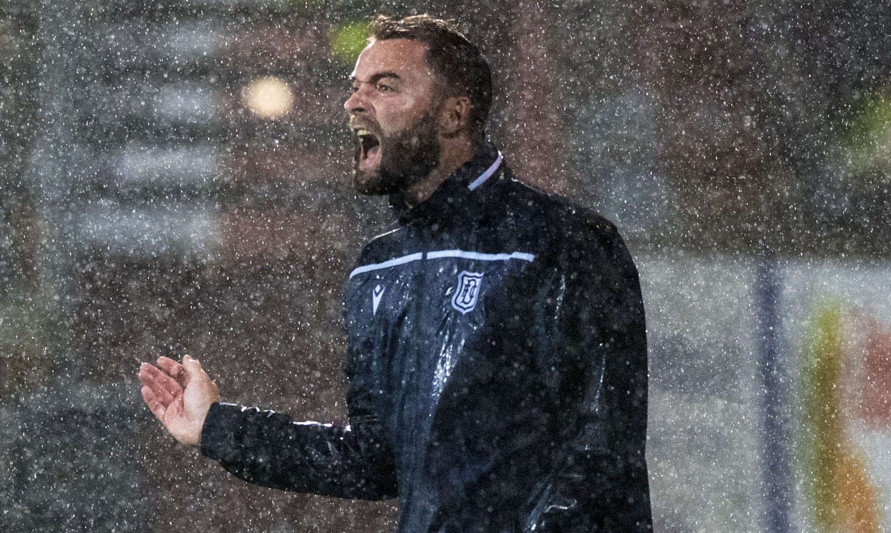 Pain in the rain for James McPake at Tannadice during the August derby.