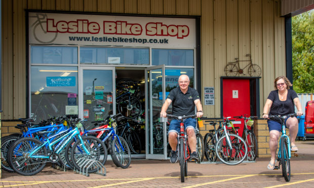 Previous owners Andy and Fiona Hain outside the shop in Glenrothes.