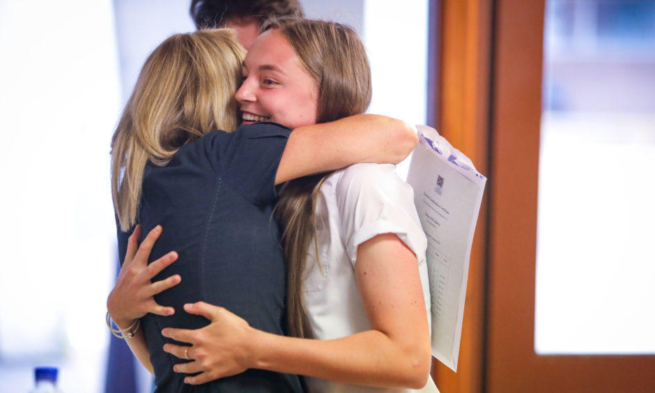 More than 136,000 candidates completed SQA exams, courses and awards last year. Robyn McCafferty, at Woodmill High School, Dunfermline got a congratulatory hug from her mum after receiving her results.