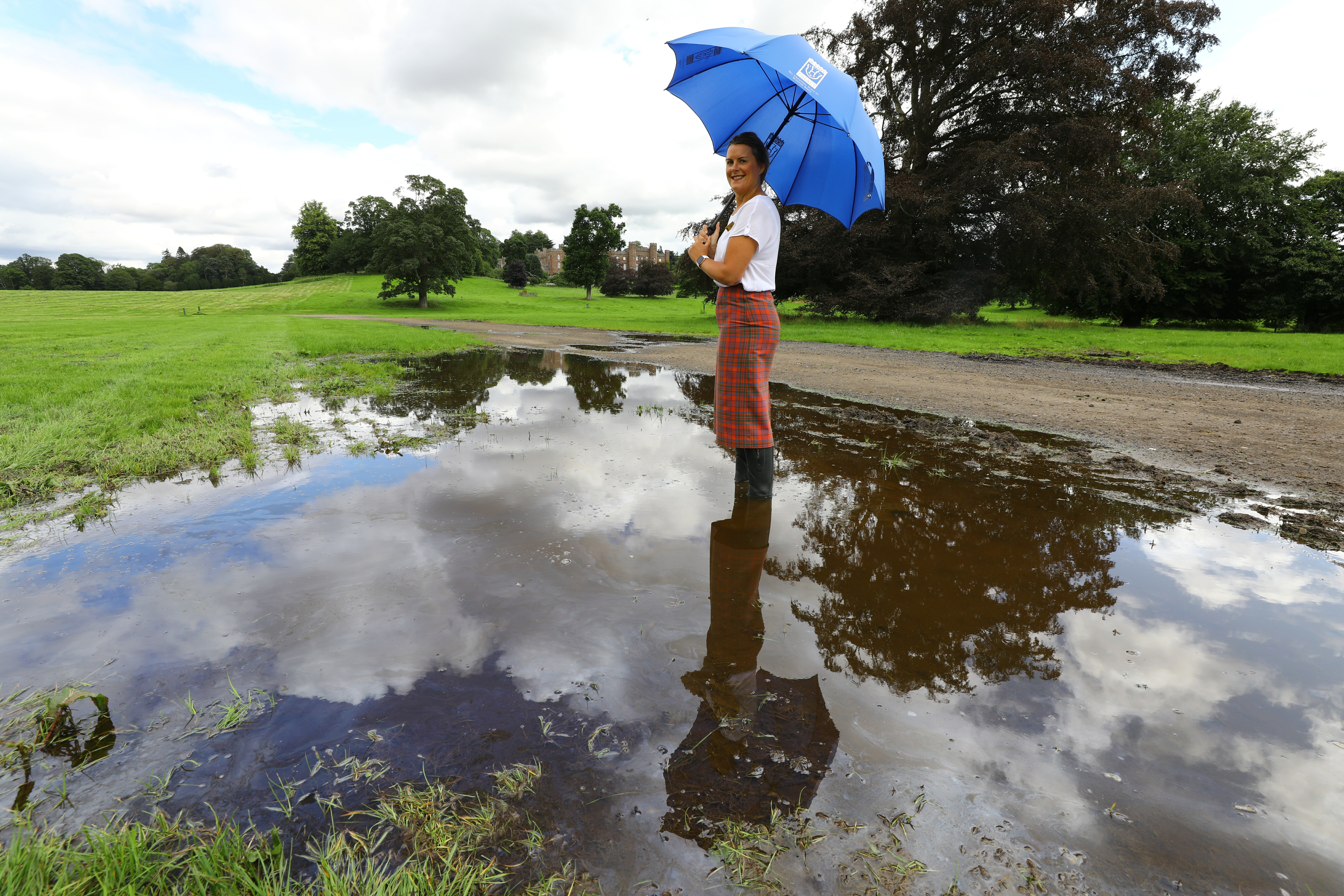 Scone Palace Retail Assistant, Lee Trussell braving a large puddle,