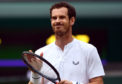 Andy Murray during his mixed doubles match with Serena Williams on day eight of the Wimbledon Championships at the All England Lawn Tennis and Croquet Club, Wimbledon.