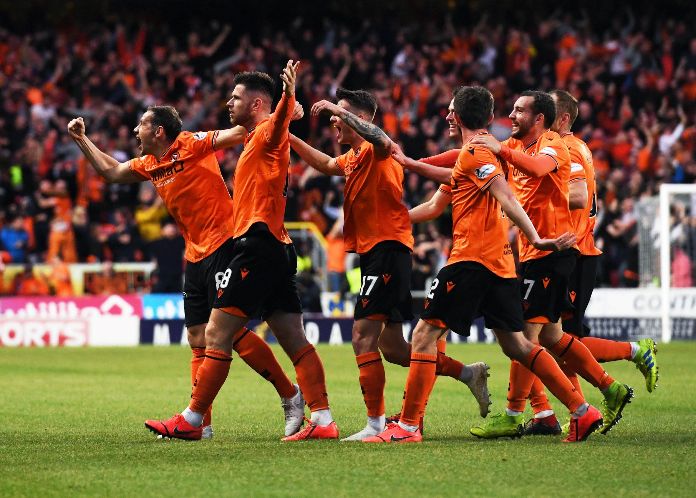 United's players celebrate Calum Butcher's opening goal.