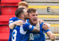 Callum Hendry celebrates his goal against Livingston.