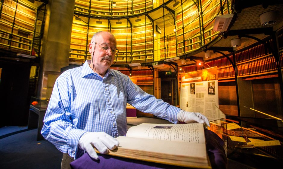 Guest curator Professor Rab Houston, University of St Andrews, with the rare prison register.