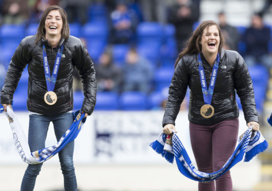 Eve and Vicki Adams show off their Olympic medals at McDiarmid Park.