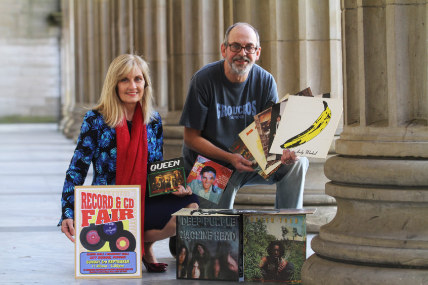 Caird Hall manager Susan Gillan and Alastair Brodie promoting vinyl ahead of a city Music Fair.