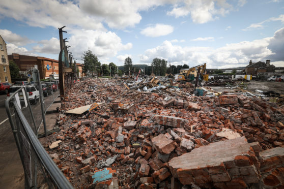 Demolition work has started on the former council offices at The Atrium in Perth to make way for a large-scale care home