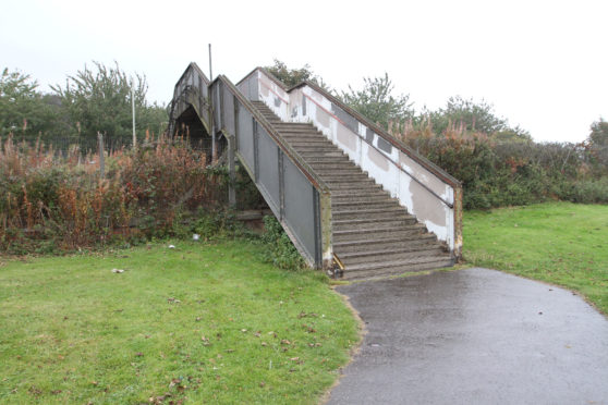 The footbridge connects Magdalen Green to Riverside Drive
