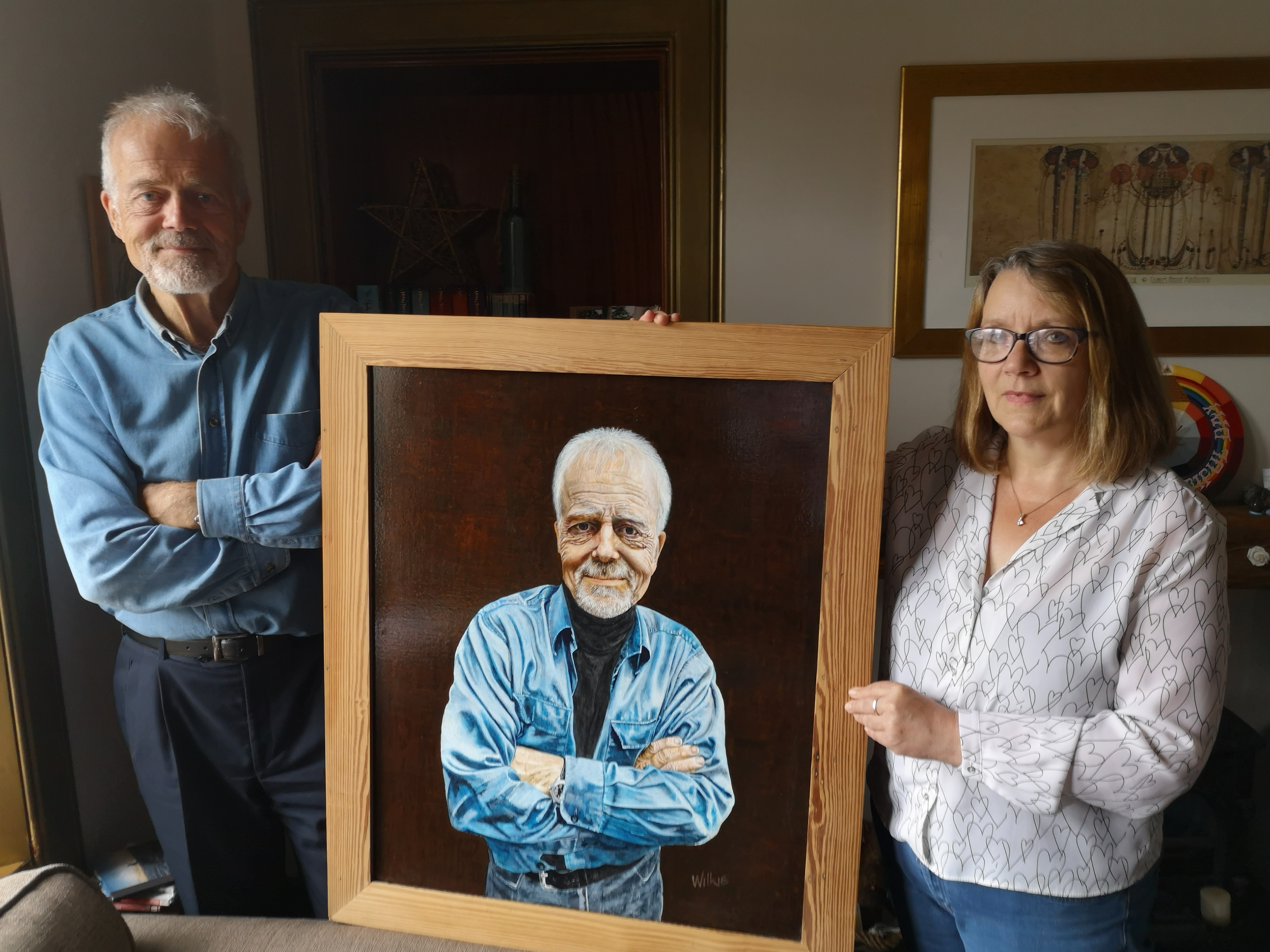 Susan Wilkie with Malcolm Robertson and the portrait.