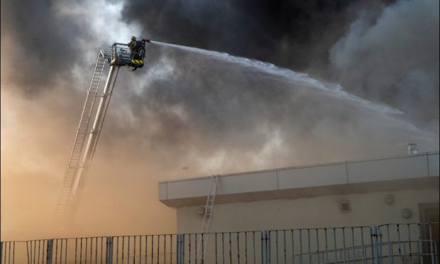 Firefighters tackling the  blaze at Woodmill High School.