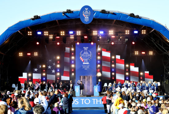 The teams take the stage at the Opening Ceremony of the Solheim Cup.