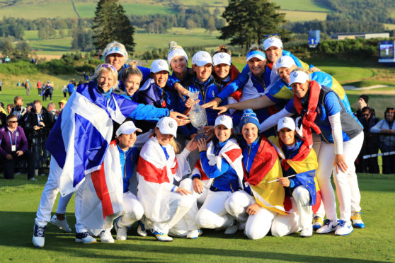 The victorious European team with the Solheim Cup.